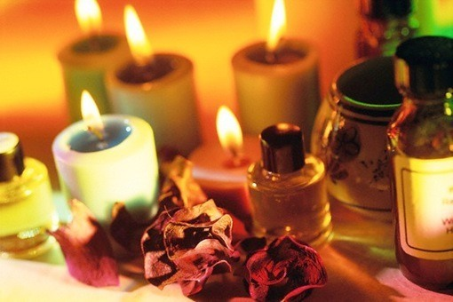 ca. 2002 --- Five candles are lit near other aromatherapy tools. --- Image by © David Aubrey/CORBIS